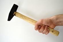 Man's Hand Holding Hammer Isol...
