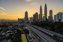Petronas Towers In City During Sunset