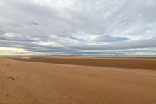 The Vast Sandy Beach At Formby In Merseyside, At Low Tide
