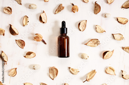 Fototapeta amber glass bottle with glass dropper with natural product