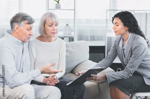 Aged couple talking to their financial advisor Wallpaper Mural