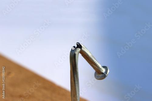 Vászonkép Broken and defective new metal nail closeup