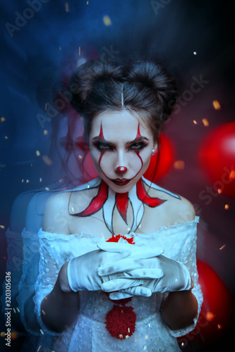 Fotografia Young modern woman clown old costume creative bright art makeup hairstyle two bun