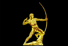 Golden Statue Of An Antique Bowman Or An Archer On A Black Background. Shining Ancient Warrior With Bow Profile View.
