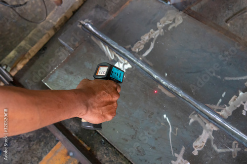 Fotografie, Obraz Measure interpass temperature on heat affected zone (HAZ) with Infrared Thermometer in process pre-qualification record(PQR)