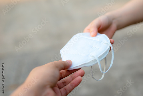Photo Hand give to / grant / assign / deliver N95 mask or respirator for protect PM 2