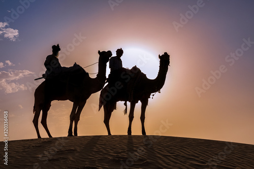 Valokuva Two men on camels in the Thar desert at sunset, Rajasthan, India