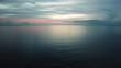 High drone aerial shot of the Atlantic ocean with a light blue and pink sky