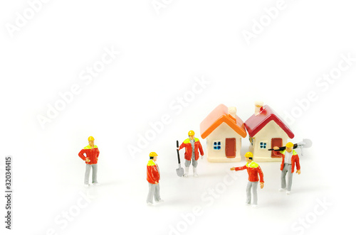 Selective focus miniature foreman command and assigning job for workers, discussing meeting and planning make the schedule to finished build home on time Canvas Print