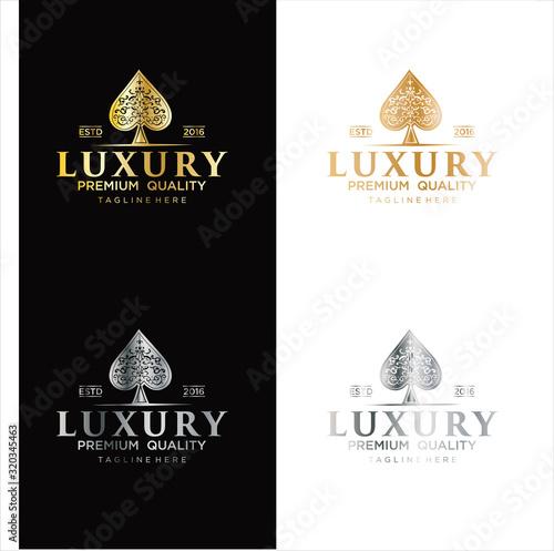 Fényképezés Gold Spade Luxury Logo vector, The heart ace gold Logo Design Vintage Hipster Re