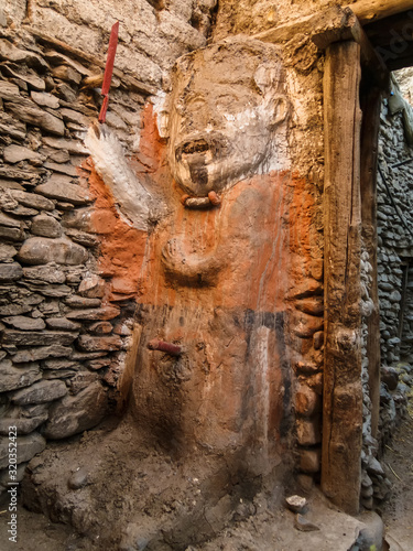 An ancient animistic male totem guarding a street in the village of Kagbeni in Upper Mustang in the Nepal Himalaya Canvas Print