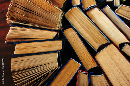 Old and well used hardback books or text books in a book shop or library Tapéta, Fotótapéta