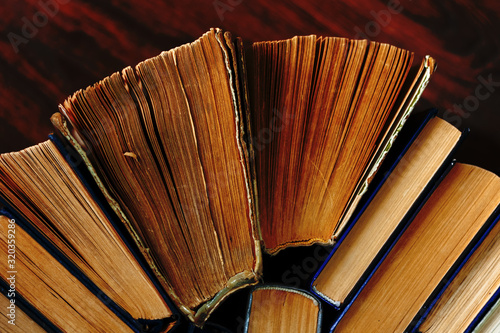 Old and well used hardback books or text books in a book shop or library Slika na platnu