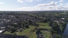 Aerial Reverse Reveal Shot Of Barnard Castle Over The River Tees