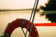 Lifebuoy Red On Yacht At Sunse...