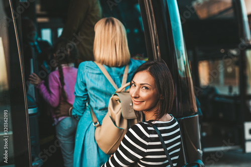 mata magnetyczna Group people boarding on travel bus. Traveling, tourism and vacation concept.