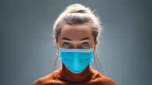 Woman Wearing Blue Medical Protective Mask To Health Protection From Influenza Virus, Epidemic And Infectious Diseases