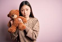 Young Asian Woman Hugging Tedd...