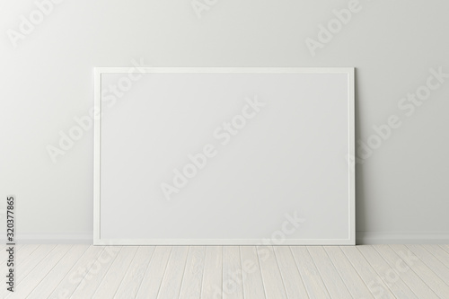 Fotografía Blank horizontal poster frame mock up standing on white floor next to white wall