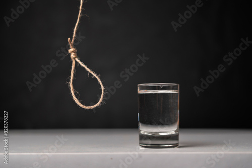 alcohol is killing your body, rope loop near the glass, alcoholism addiction con Canvas Print