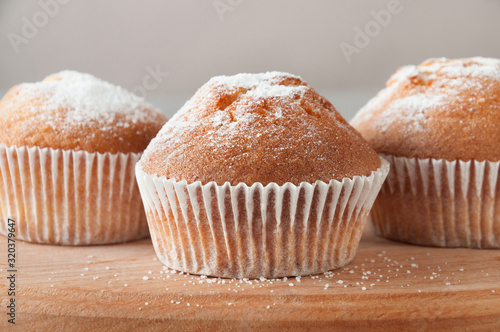 Fotografie, Obraz Tasty muffin closeup on a wooden board, selective focus.