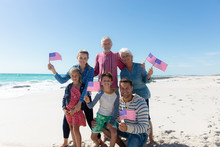 Family With American Flag At T...