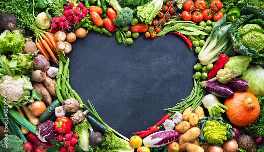 Fototapeta Food background with assortment of fresh organic vegetables
