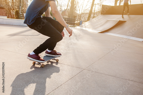 Unrecognizable skateboarder on his board. Photo was taken in backlight