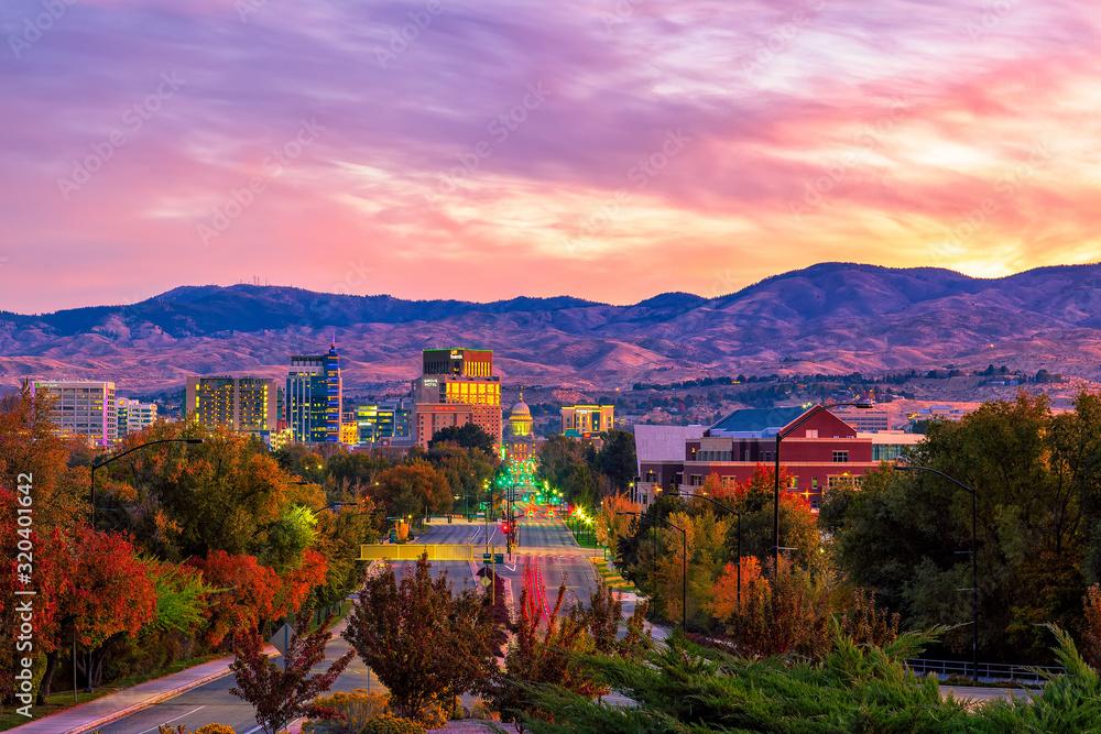 Fototapeta Boise Idaho skyline morning sunrise with light street traffic