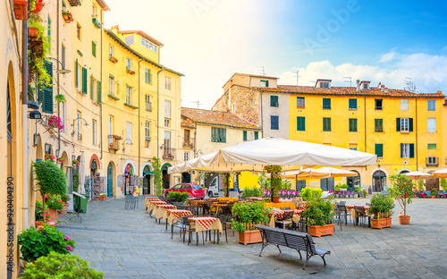 Cafe in the cozy morning lighted square of the old European city.