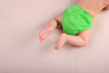Baby's Feet And Green Reusable...