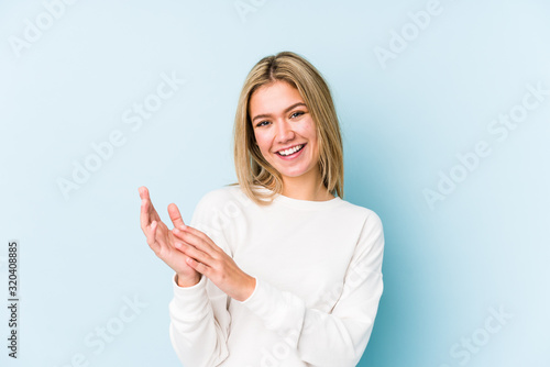 Fotografie, Tablou Young blonde caucasian woman isolated feeling energetic and comfortable, rubbing hands confident