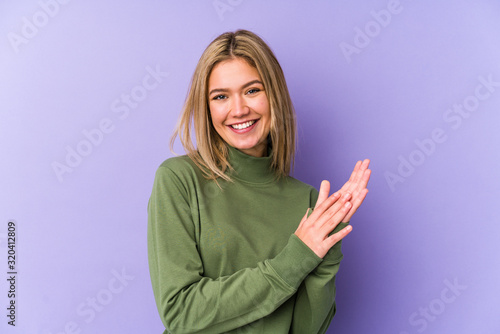 Young blonde caucasian woman isolated feeling energetic and comfortable, rubbing hands confident Poster Mural XXL