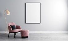 Vertical Blank Picture Frame In Empty Room With White Wall And Armchair On Wooden Parquet. Room Interior With Armchair And Blank Frame For Mockup. 3d Rendering
