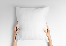 White Blank Square Pillow Mockup, Woman Holding With Two Hands On Isolated Background