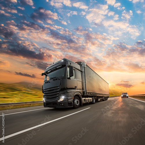mata magnetyczna Truck with container on highway, cargo transportation concept. Shaving effect.