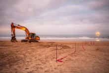 Excavator On Beach With Ship O...