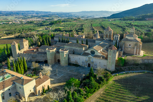Photo Aerial view of the Royal Abbey of Santa Maria de Poblet a Cistercian fortified m