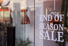 End Of The Season Sale Sign On The Window Shop Of Fashion Clothing Boutigue