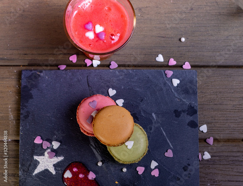 Fototapeta macarons on a plate with decoration for valentines obraz