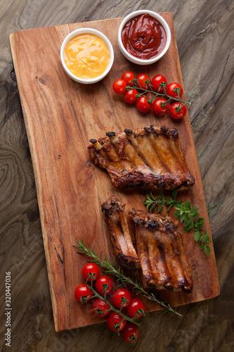 Fototapeta Grilled Pork Ribs On Wooden Board obraz