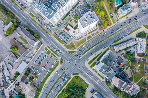 Obraz aerial top view of urban road intersection on a summer day. car traffic on city crossroad - fototapety do salonu