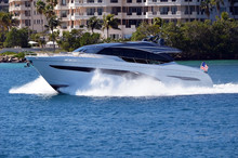High-end Cabin Cruiser Speeding Past Luxury Island Condos In Miami Beach,Florida