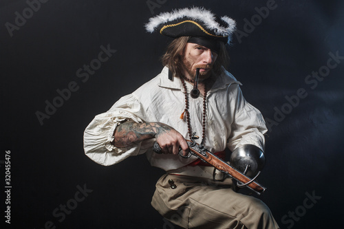 medieval bearded pirate with a sword and gun Fototapeta