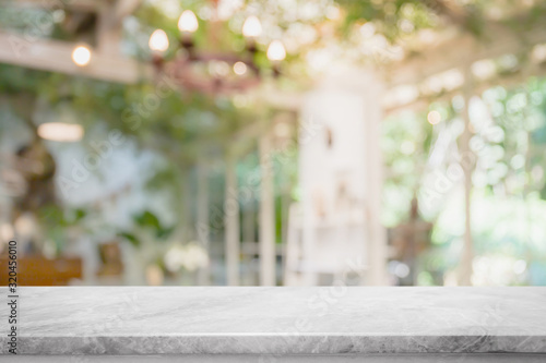 Empty white marble stone table top and blurred of interior room with window view from green tree garden background background - can used for display or montage your products.