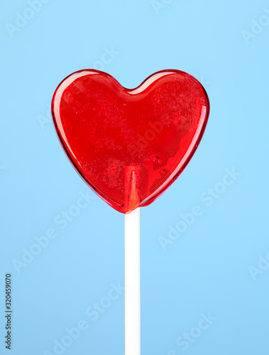 obraz PCV Shiny red lollipop in the shape of a heart for Valentine's day.