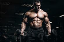 Muscular Man Bodybuilder Train...