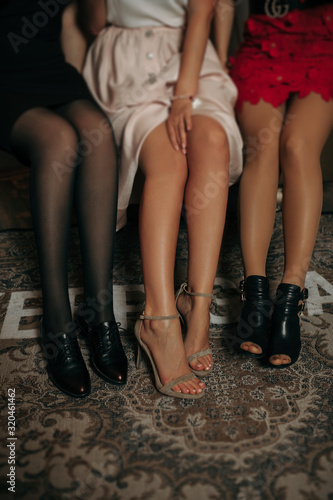 long naked sexy legs of three girls in open shoes with spikes - 320461462