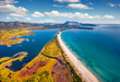 Leinwanddruck Bild View from flying drone. Stunning spring view of La Cinta beach. Splendid morning scene of Sardinia island, Italy, Europe. Aerial Mediterranean seascape. Beauty of nature concept background.