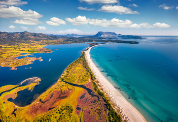 Fototapeta Morze View from flying drone. Stunning spring view of La Cinta beach. Splendid morning scene of Sardinia island, Italy, Europe. Aerial Mediterranean seascape. Beauty of nature concept background.